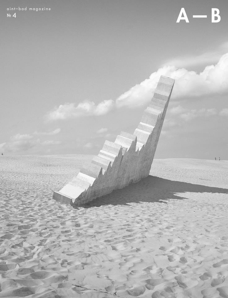 Cover of Aint-Bad Magazine no. 4, monument in the sand